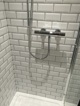 Traditional tiles in small shower