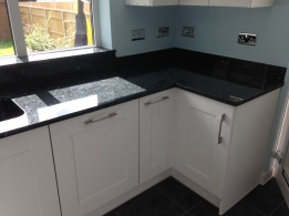 Kitchen in Chandlers Ford with granite